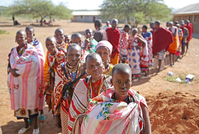 Masai wait to cast their ballots in front of a polling station,, Kenya
