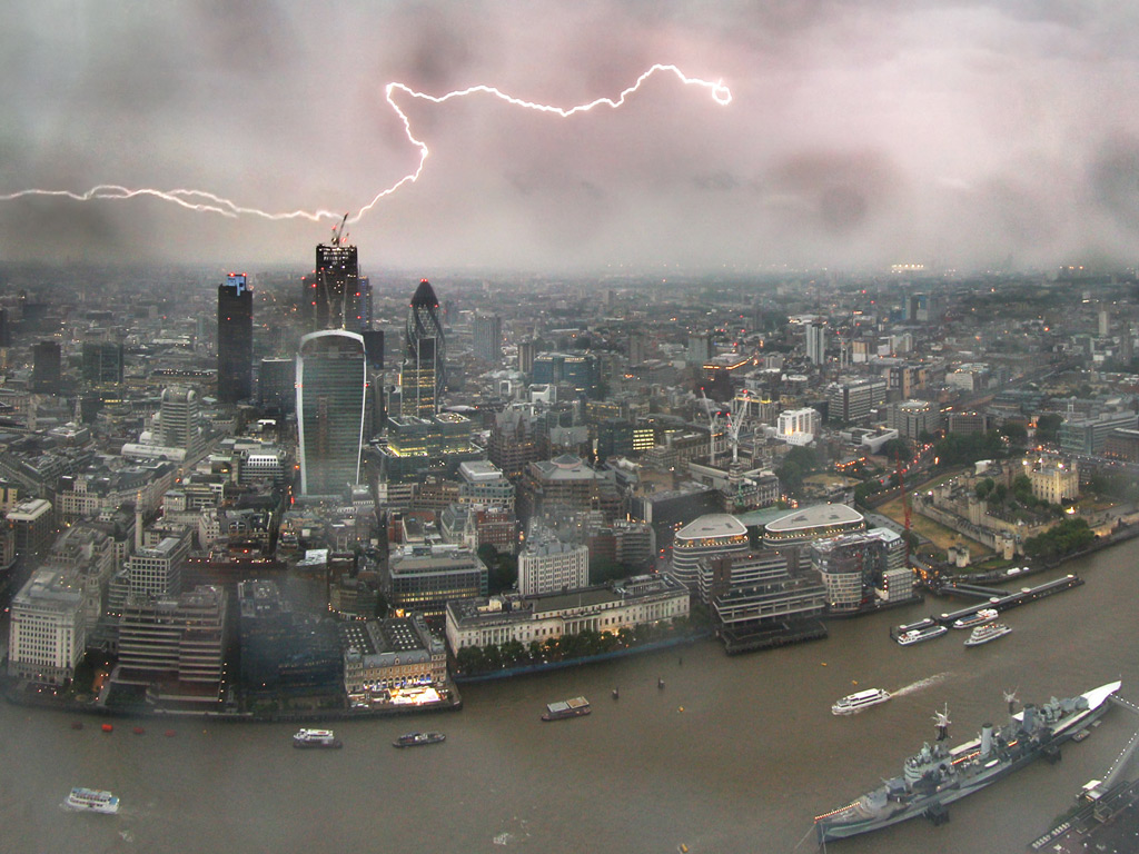 Lightning arcs across the skyline in an image taken from the Shard. The recent weeks of clear skies